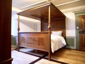 Antique four-poster beds for our future guests
